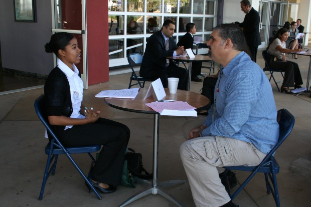 students practice interview skills at corona business expo